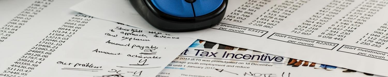 calculator pen papers coins taxes